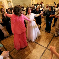 Chaya Zippel dances with female guests after marrying Rabbi Mendy Cohen in a traditional Chabad Lubavitch Jewish ceremony at the Grand America Hotel in Salt Lake City on Monday, Sept. 12, 2016. The men and women celebrate in different areas.