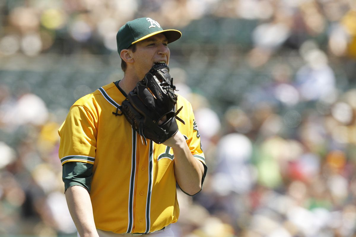 Not only does he chew gum, Jarrod Parker also eats his glove.