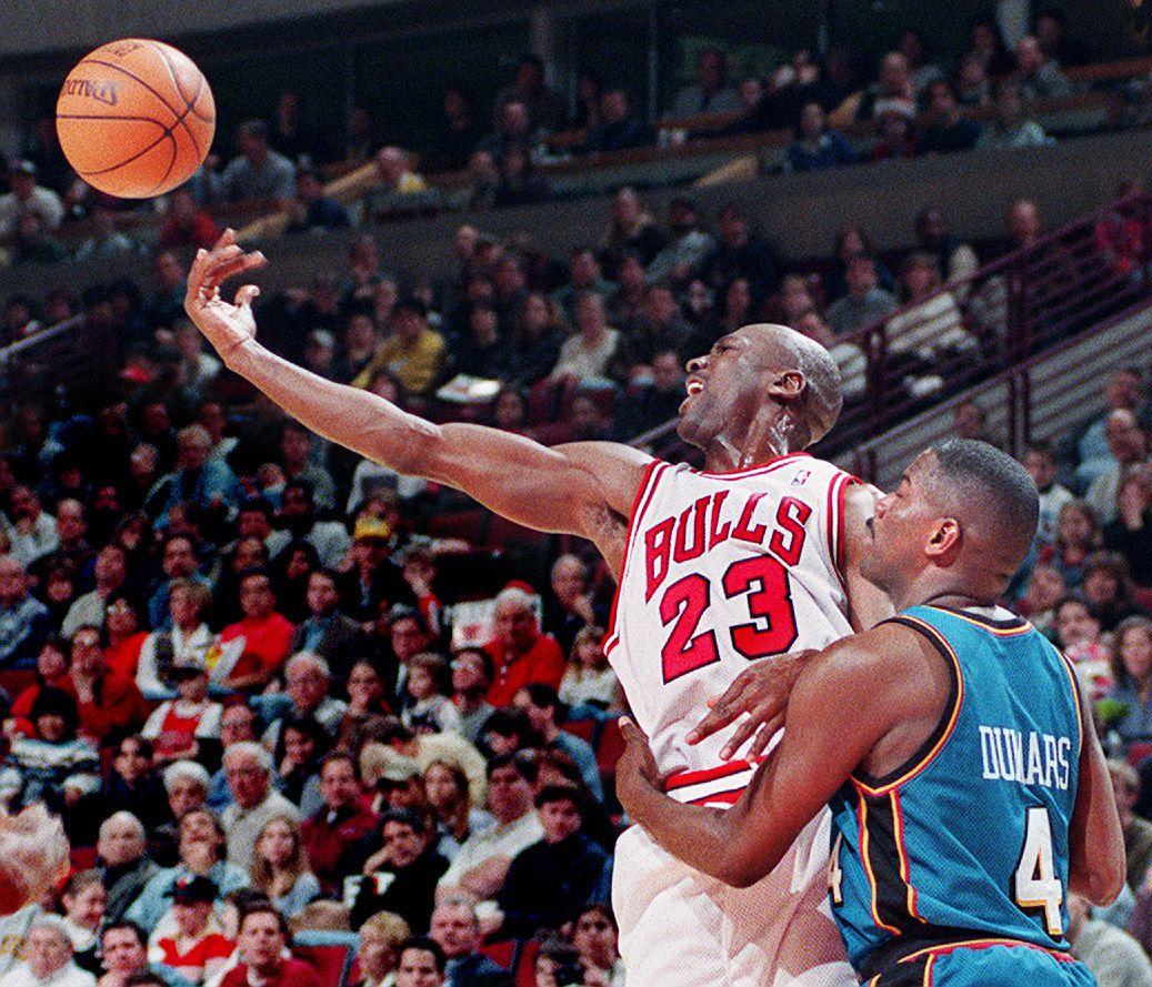 Michael Jordan is fouled by the Pistons' Joe Dumars.