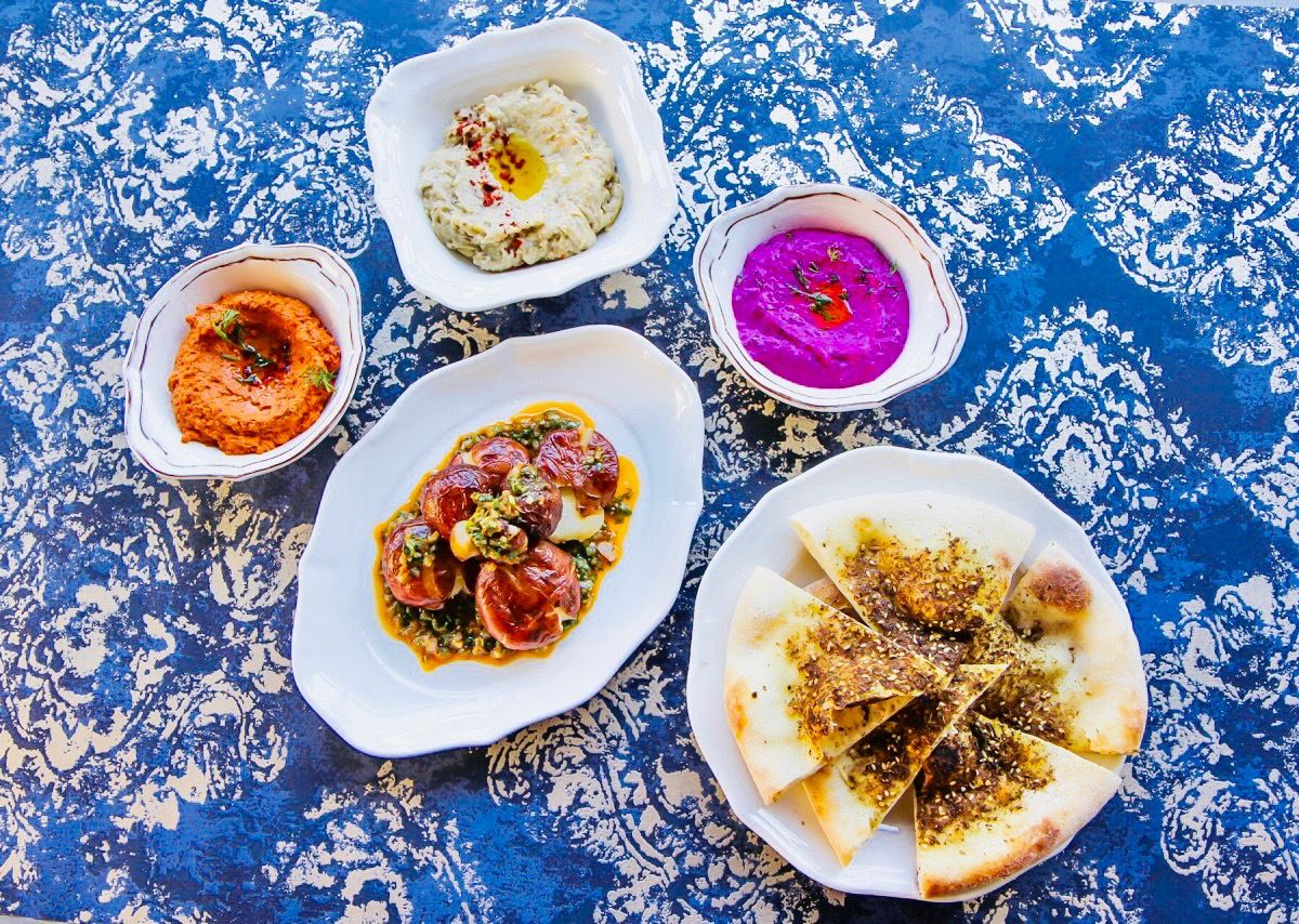 Overhead view of five colorful Eastern Mediterranean dishes