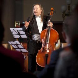Bosnian musician Vedran Smajlovic addresses the auditorium before playing his cello at one of the ceremonies being held to mark the 20th anniversary of the start of the 44-month Bosnian Serb siege of Sarajevo, part of the 1991-95 Bosnian war, in  Sarajevo, Bosnia, Thursday, April 5, 2012. Twenty years ago, as mortar shells began raining down on Sarajevo, killing his friends and neighbors, Vedran Smajlovic did what he knew best to help the city: he played his cello at funerals, in bomb shelters and in the streets.