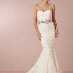 """<a href=""""http://www.bhldn.com/shop-the-bride-wedding-dresses/poppy-gown/productoptionids/fbcaeb8b-b90b-4e9a-9313-32da085940dd"""">Poppy Gown</a>, $2,200"""