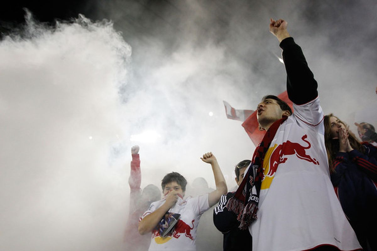 Fans of the New York Red Bulls celebrates celebrate during their game against the New England Revolution on October 21 2010 at Red Bull Arena in Harrison New Jersey.  (Photo by Mike Stobe/Getty Images for New York Red Bulls)