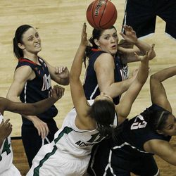 Notre Dame forward Devereaux Peters (14), Connecticut guard Kelly Faris (34) Notre Dame forward Natalie Achonwa (11) Connecticut center Stefanie Dolson (31) Connecticut forward Kaleena Mosqueda-Lewis (23) vie for a lose ball  during the first half of the NCAA women's Final Four semifinal college basketball game, in Denver, Sunday, April 1, 2012.