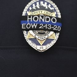 A ribbon is worn over a police badge during memorial services for Herriman police K-9 Hondo at Herriman High School in Herriman on Saturday, Feb. 29, 2020. The 7-year-old Belgian Malinois was shot and killed in the line of duty on Feb. 13 while trying to apprehend a wanted violent fugitive who was also shot and killed after officers say he displayed a gun.