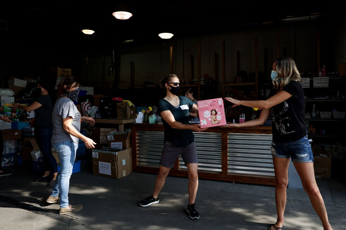 Volunteers at the Living Waters Church in Medford, Ore., unload a trailer of donated goods for fire victims on Wednesday, Sept. 23, 2020.