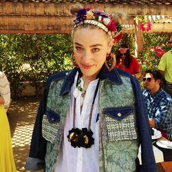 No one knows how to accessorize like DJ Mia Moretti. That vibrant headpiece is out-of-this-world.