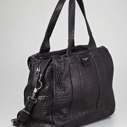 """The pebble-textured leather and roomy construction of this classic satchel make it a winner. $331, <a href=""""http://www.cusp.com/product.jsp?rte=%252Fetemplate%252Fp6E.jsp%253FparentId%253Dcat110001%2526N%253D4294965449%252B4294965456%2526itemId%253Dcat110"""