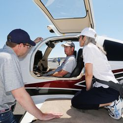 Zachariah Powell, of Textron Aviation, explains the Cessna TTX plane to Eric and Raquel Thorman during the Skypark Aviation Festival and Expo at Skypark Airport in Woods Cross on Friday, June 2, 2017. The expo is Utah's largest annual aviation event.