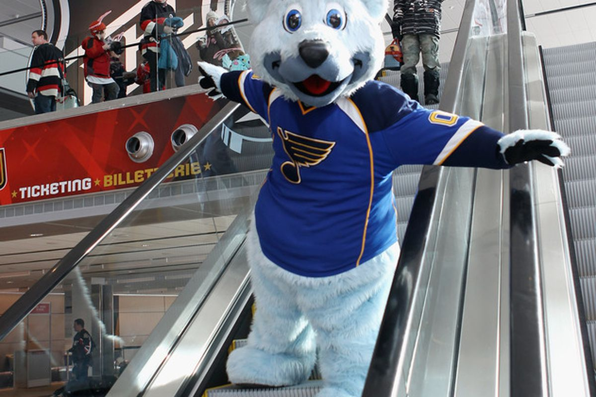 Dear Scottrade, notice the WORKING ESCALATOR! Dear Louie, notice YOU'RE NOT WEARING ANY PANTS!