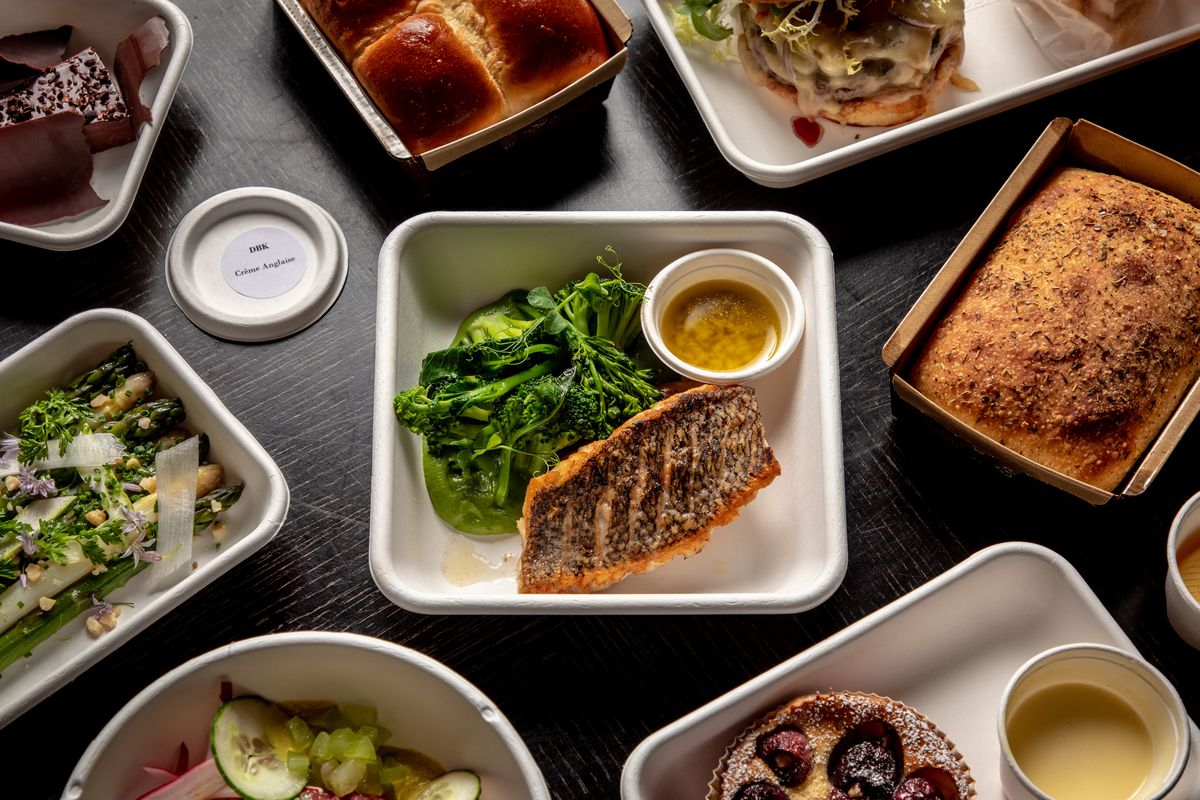 A spread of food in takeout containers at Daniel.