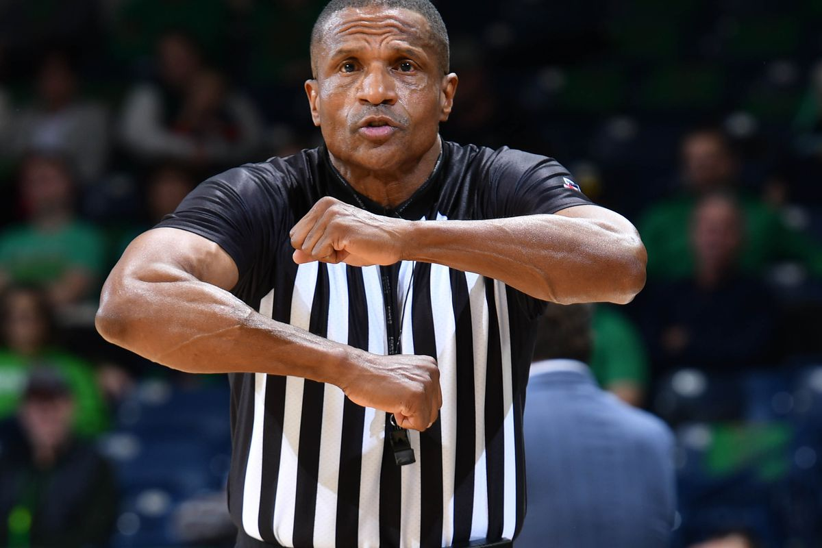 NCAA referee Ted Valentine makes a call in the first half of a game between the Notre Dame Fighting Irish and the Boston College Eagles at the Purcell Pavilion.