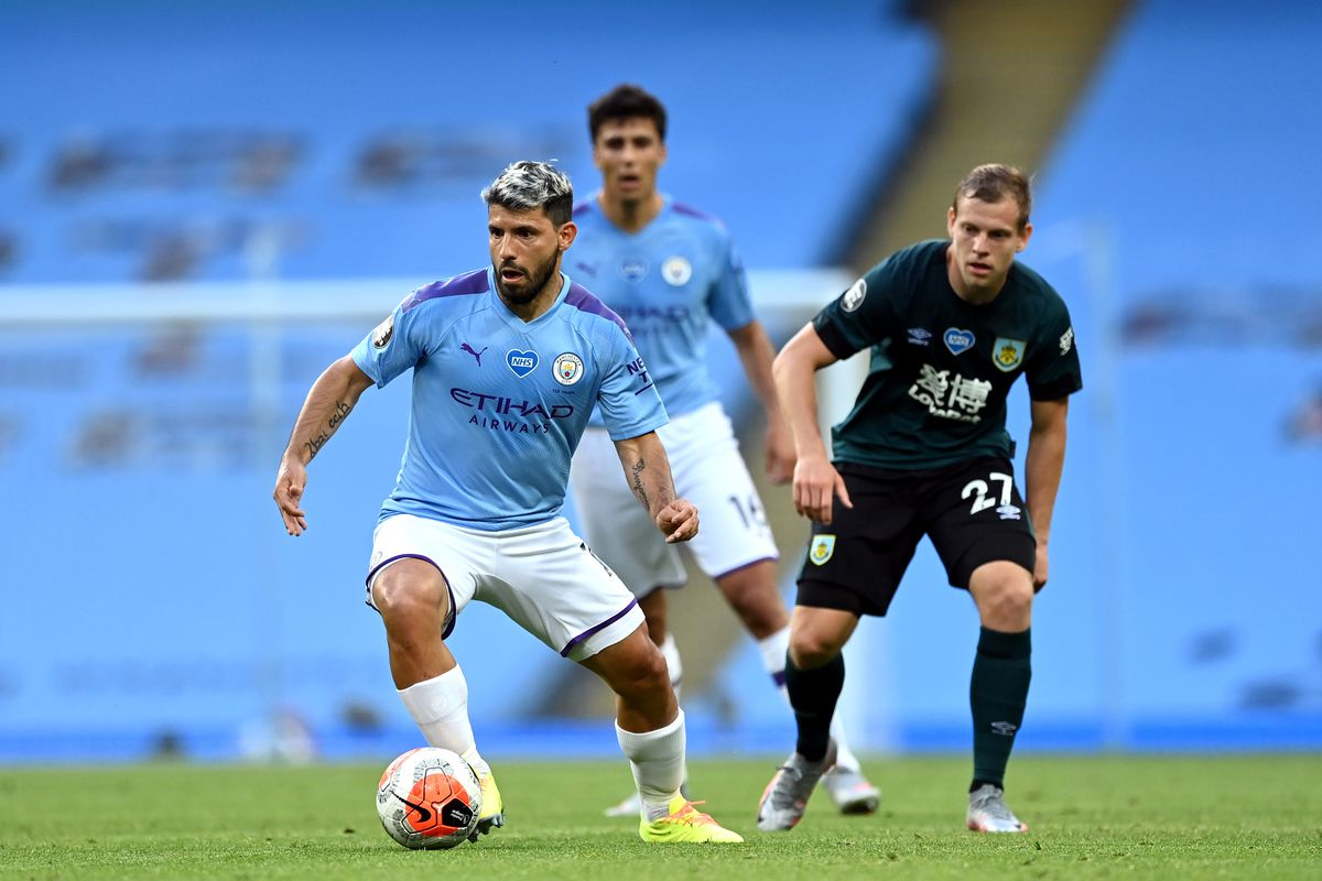 Sergio Aguero of Manchester City breaks with the ball during the Premier League match between Manchester City and Burnley FC at Etihad Stadium on June 22, 2020 in Manchester, England.