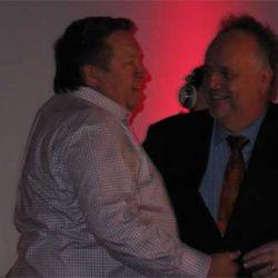 Tony Mantuano gives Scott Harris his lifetime achievement award