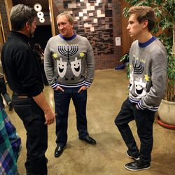 Scott Maizlish and his son Joey Maizlish wear matching sweaters at the annual Hanukkah party at Temple Har Shalom in Park City on Saturday, Dec. 13, 2014.