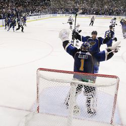 St. Louis Blues defenseman Alex Pietrangelo celebrates with goaltender Brian Elliott as time expires against the San Jose Sharks in Game 5 of an NHL Stanley Cup first-round hockey playoff series, Saturday, April 21, 2012, in St. Louis. The Blues won 3-1 and won the series 4-1.