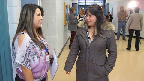 Castro Elementary parent liaison Veronica Luna, left, talks about plans for a new early childhood center with parent Cynthia Vasquez.