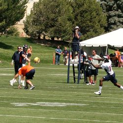 Peyton Manning throws to Tavarres King during the second day of training camp