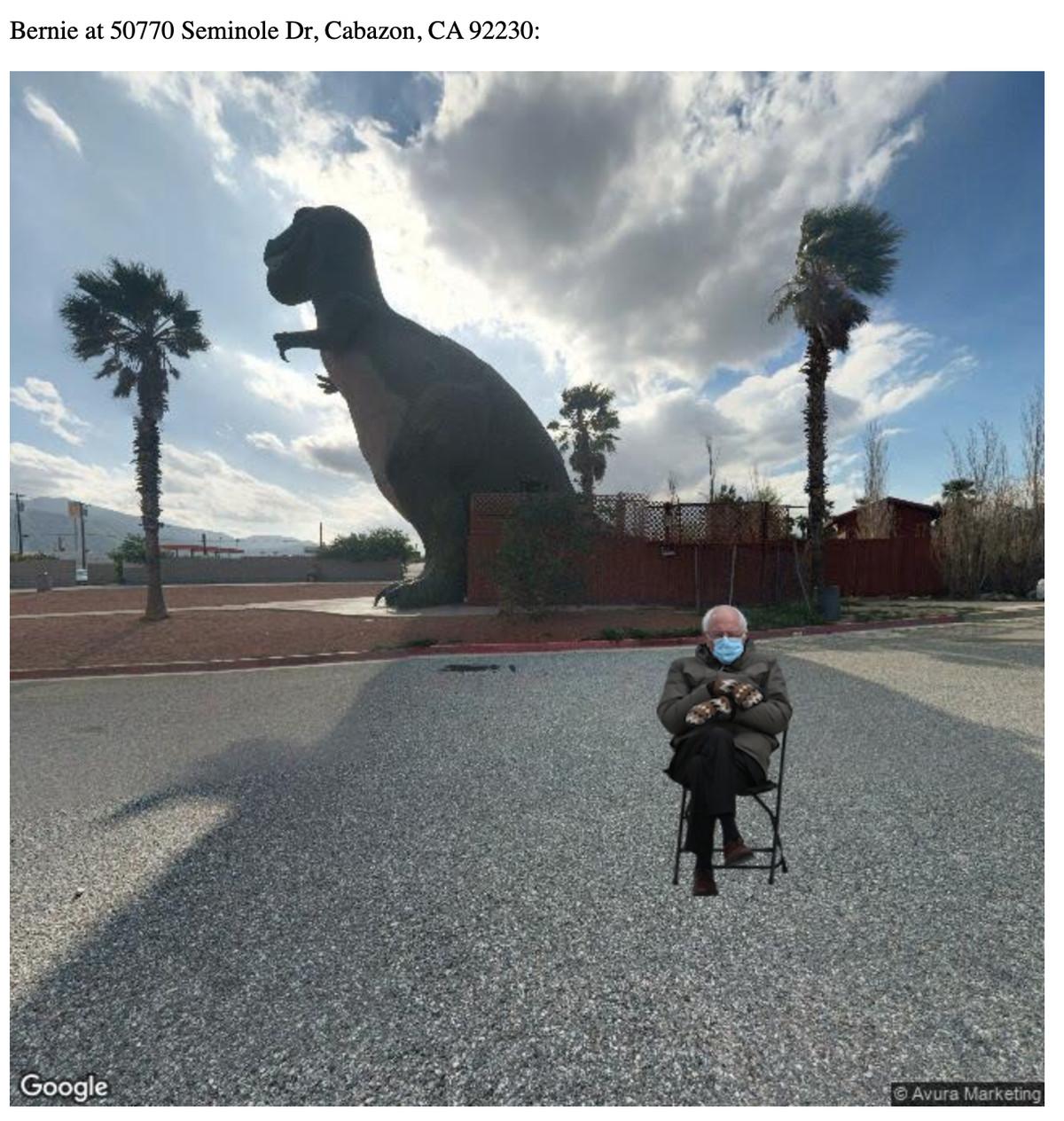 Bernie Sanders sitting in front of a t-rex statue