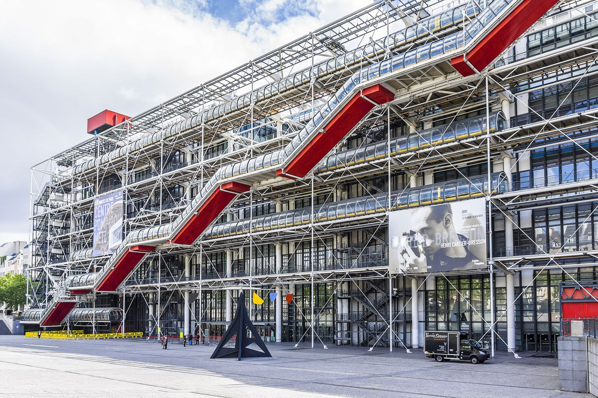 The exterior of the Pompidou Center in France. The facade is many steel support beams and metallic structures.