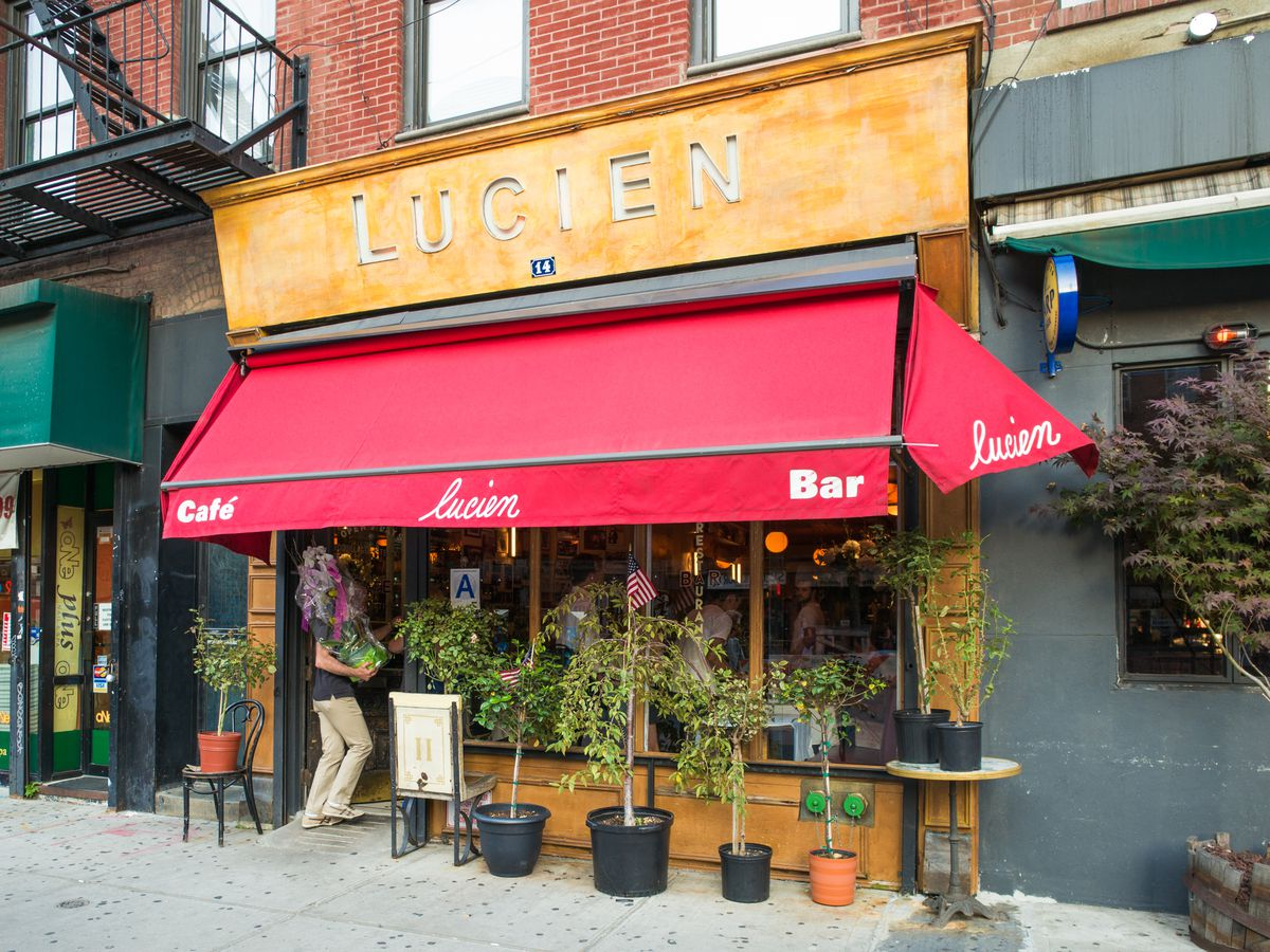 The entrance to Lucien with a red awning