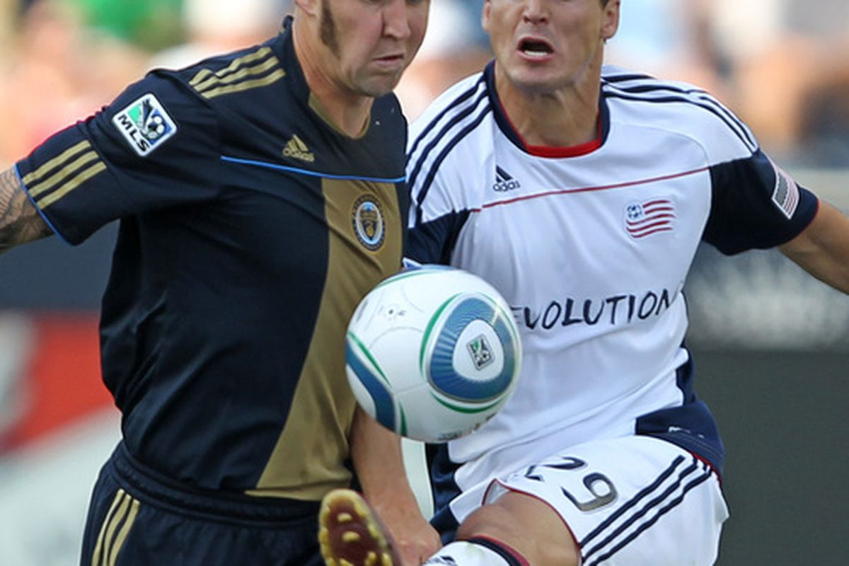 CHESTER PA - JULY 31: Defender Danny Califf #4 of the Philadelphia Union battles midfielder Marko Perovic #29 of the New England Revolution during a game at PPL Park on July 31 2010 in Chester Pennsylvania. (Photo by Hunter Martin/Getty Images)