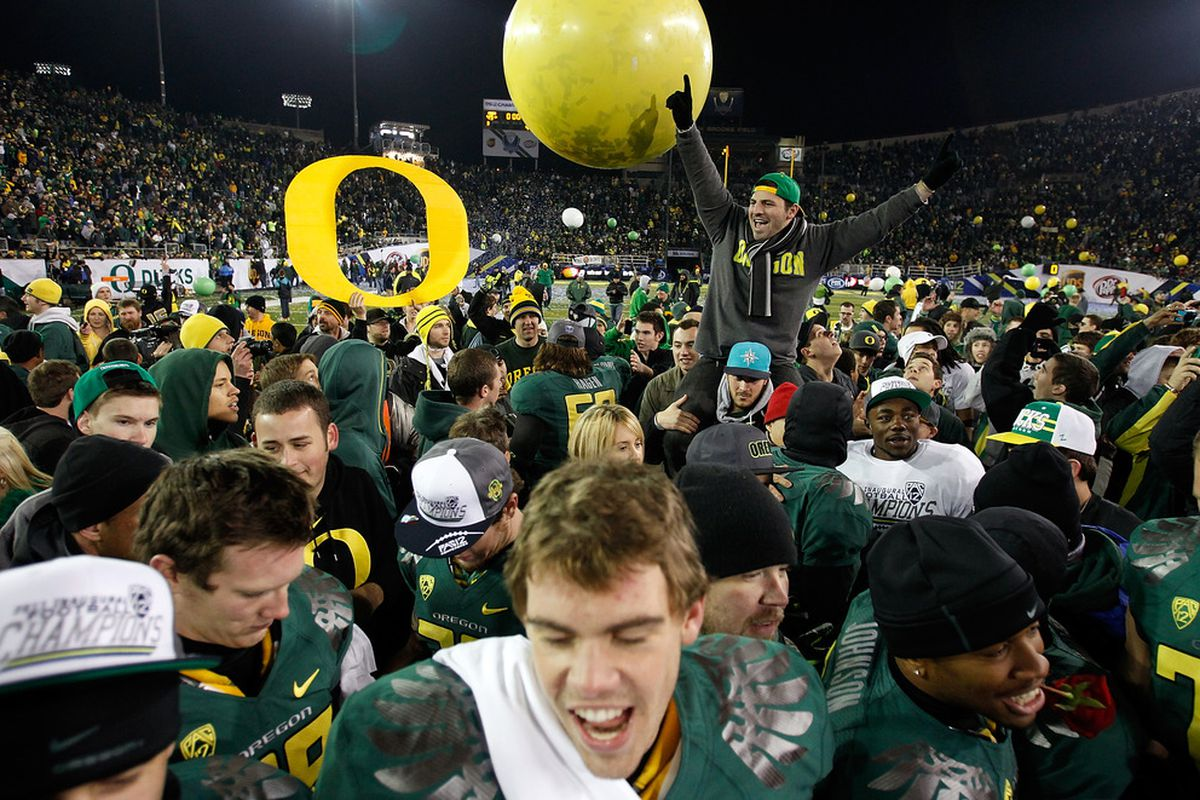 EUGENE, OR - DECEMBER 02:  Fans celebrate the Oregon Ducks 49-31 victory over  the UCLA Bruins  during the Pac 12 Championship Game on December 2, 2011 at the Autzen Stadium in Eugene, Oregon.  (Photo by Jonathan Ferrey/Getty Images)