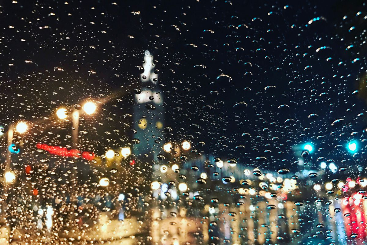 The SF Ferry Building as seen through a rain-smeared window.