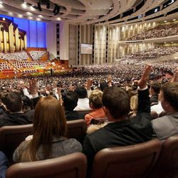 Members of the audience take part in the sustaining vote during the afternoon session Saturday, April 6, 2013 of the 183th Annual General Conference of The Church of Jesus Christ of Latter-day Saints in the Conference Center.
