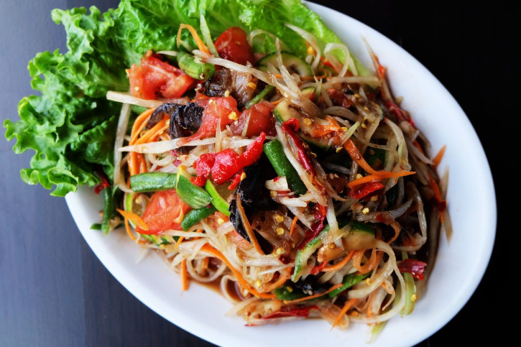A plate of som tum pu pla ra — green papaya salad with preserved crab and preserved fish.