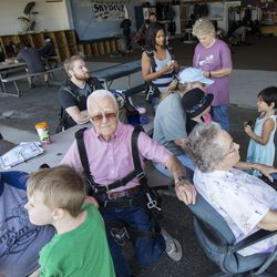 The Ashcroft family and extended family sit around the airplane hangar at Skydive Ogden waiting to watch their eight relatives skydive in Ogden on Saturday, Aug. 5, 2017. Mary and Wendell Ashcroft have four children, nine grandchildren and nine great-grandchildren.