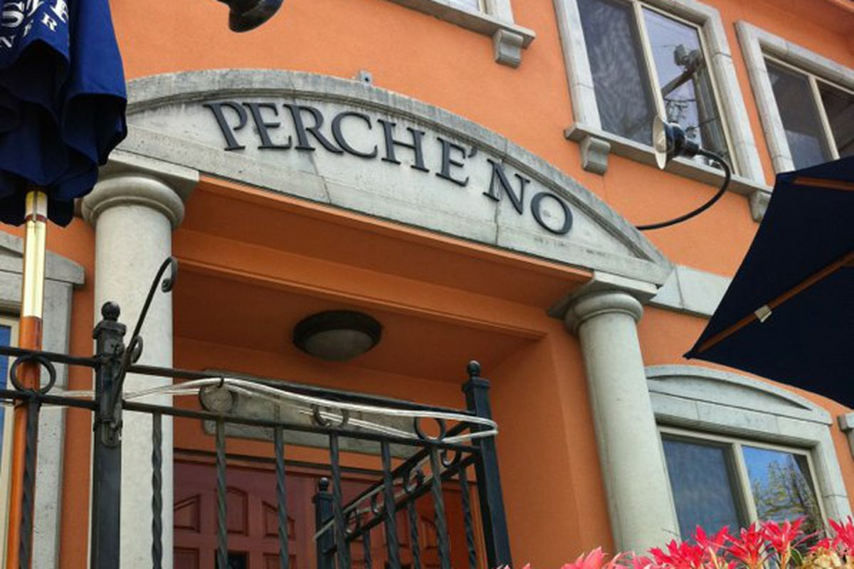 The exterior of Perché No in Green Lake, with orange paint, large columns out front, and the restaurant's name displayed across a stone arch.