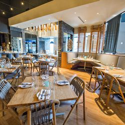 A slightly more intimate dining area for smaller parties in the corner at Drift Fish House.