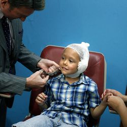Kamden Gill, who is 5 years old, gets his bandages removed by Dr. Steven Mobley at the Surgical Specialty Center in Salt Lake City on Friday, Sept. 23, 2011. Mobley performed an otoplasty to fix Kamden's protruding ears.
