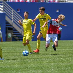 Thomas Roberts (23) fouled from behind during the opening match of the 40th Annual Dallas Cup.