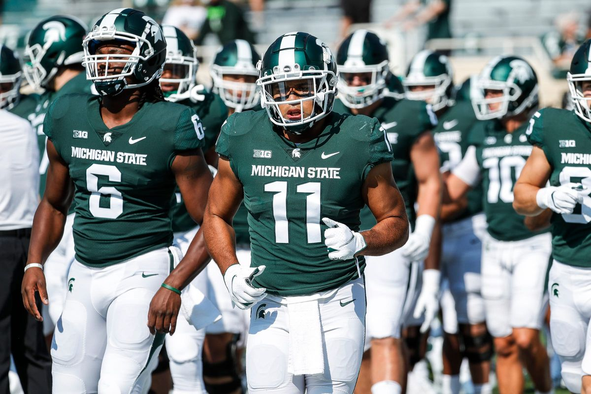 Michigan State running back Connor Heyward (11) warms up before the Youngstown State game at Spartan Stadium in East Lansing on Saturday, Sept. 11, 2021.