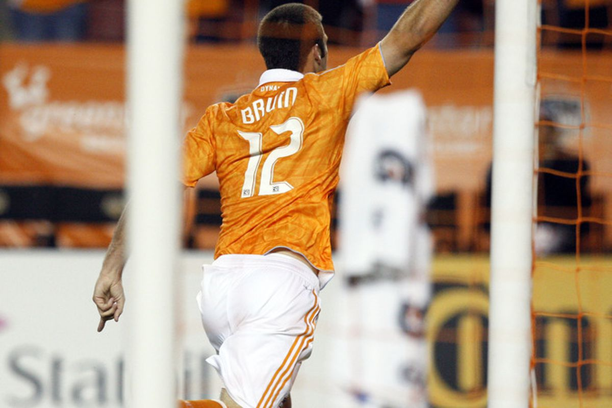 HOUSTON - APRIL 29:  Forward Will Bruin #12 of the Houston Dynamo celebrates after scoring his second goal in the first half against D.C. United at Robertson Stadium on April 29, 2011 in Houston, Texas.  (Photo by Bob Levey/Getty Images)
