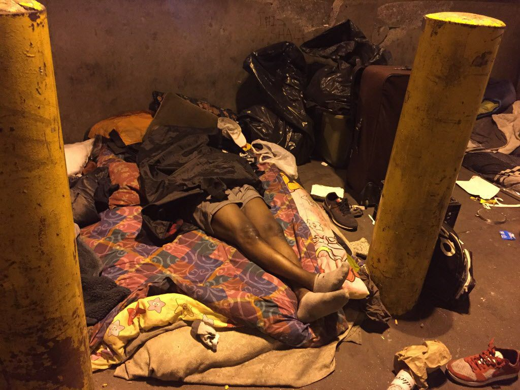 Many of the homeless residents of an area of Lower Wacker Drive known<br>as the Triangle were still asleep Tuesday morning when the city sent<br>in a team of social workers to discuss plans to remove them. Many<br>others scattered temporarily. | Mark Brow