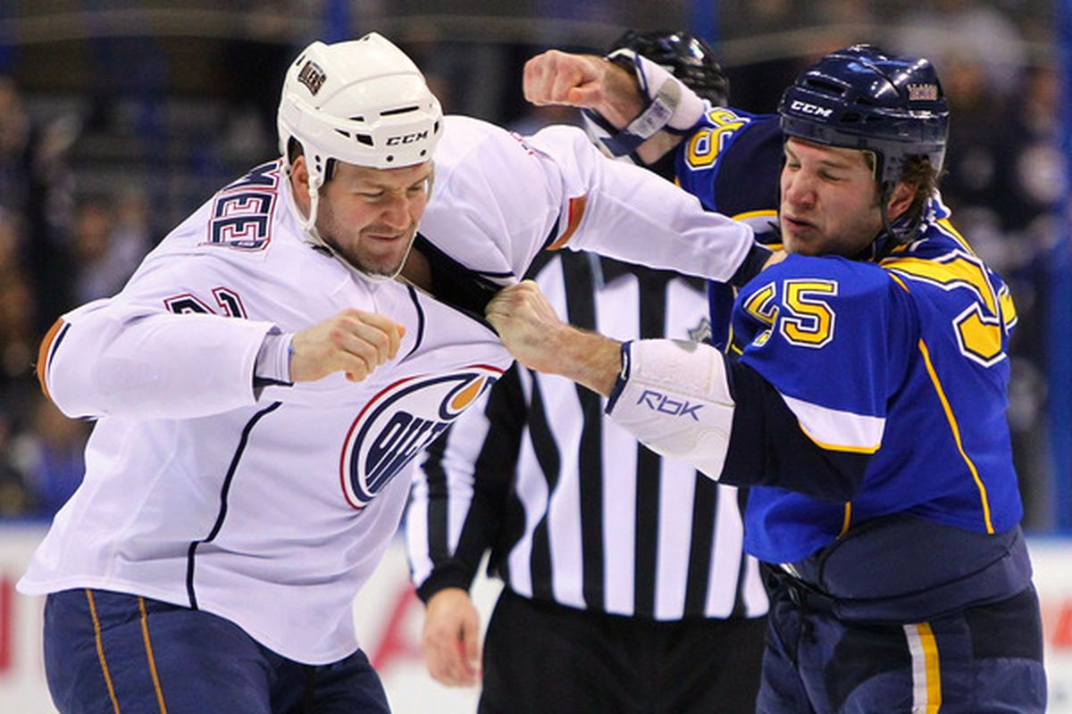 ST. LOUIS, MO - MARCH 24: Jim Vandermeer #2 of the Edmonton Oilers fights Cam Janssen #55 of the St. Louis Blues at the Scottrade Center on March 24, 2011 in St. Louis, Missouri.  (Photo by Dilip Vishwanat/Getty Images)