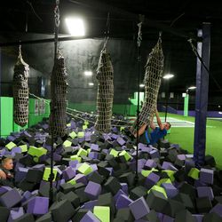 Kids play in a foam pit at Get Air Salt Lake in Murray on Friday, July 29, 2016.