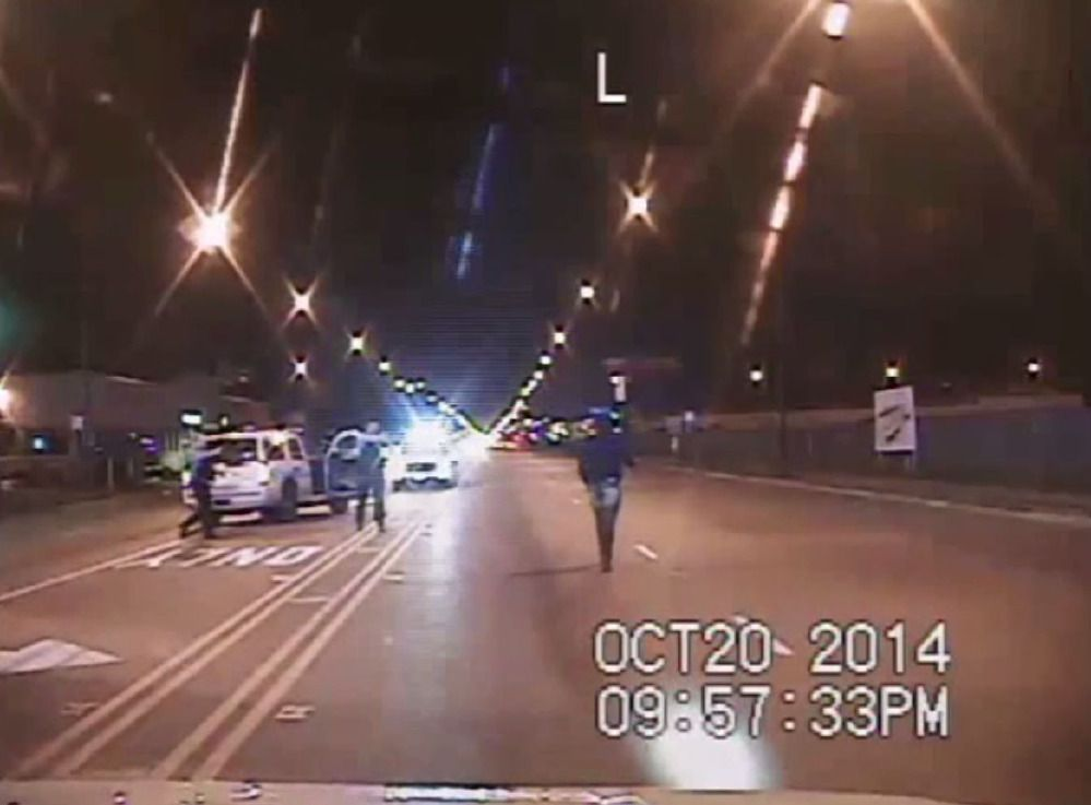 An image from the police video showing 17-year-old Laquan McDonald being shot and killed by a police officer.