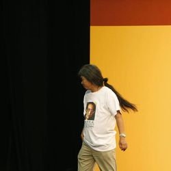 """Leung Kwok-hung, also known as """"Long Hair,"""" of the pro-democracy League of Social Democrats leaves after winning a seat on the Legislative Council in Hong Kong, Monday, Sept. 10, 2012. Hong Kong voters cast ballots in legislative elections Sunday that will help determine the eventual shape of full democracy that Beijing has promised the former British colony."""