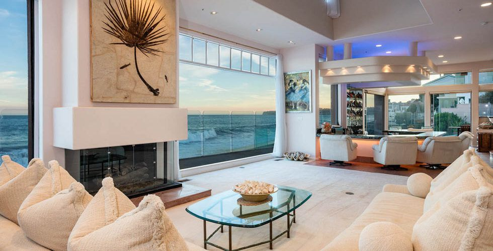 Living Room With Windows On The Water