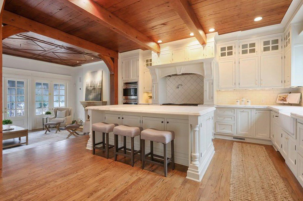 A large kitchen with a family room at left.