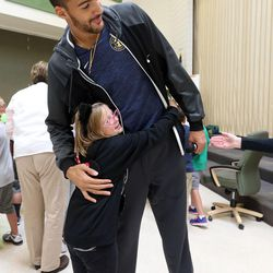 Bailey Duffin hugs Utah Jazz center Rudy Gobert after his visit with students at Foxboro Elementary School in North Salt Lake, on Wednesday, Sept. 20, 2017.
