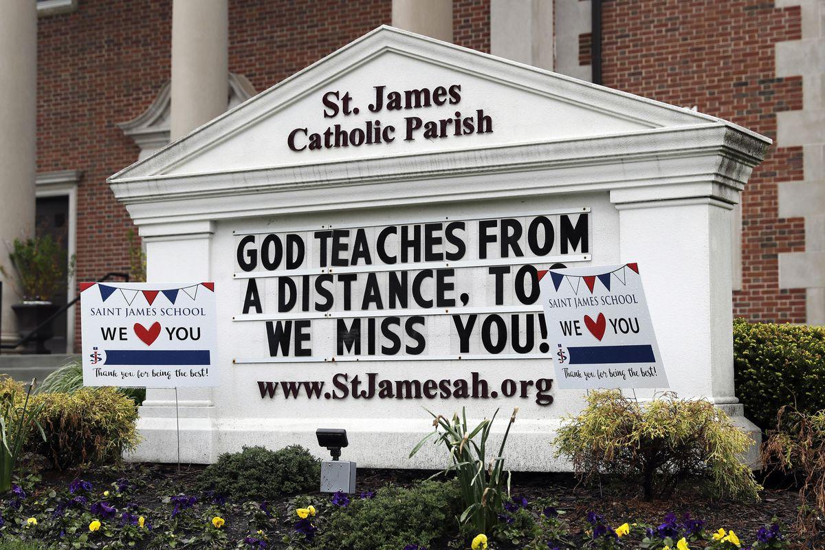 A sign at St. James Catholic Parish in Arlington Heights on May 14.