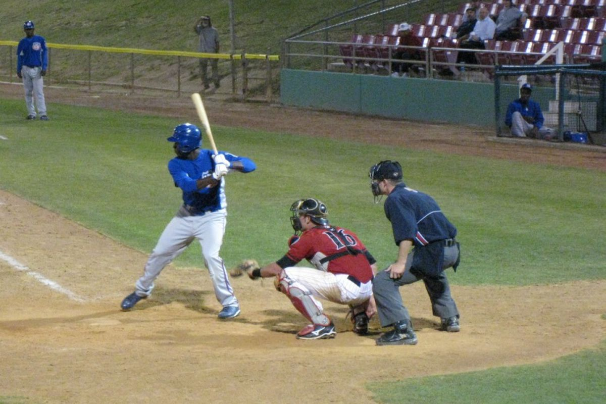 Trayvon Robinson, batting here, was one of three players added to the 40-man roster by the Dodgers today.