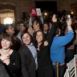 Renata Moreira, right, and partner Lori Bilella cheer after the U.S. Supreme Court's ruling on gay marriage in California, at San Francisco's City Hall on Wednesday, June 26, 2013.  The justices issued two 5-4 rulings in their final session of the term. One decision wiped away part of a federal anti-gay marriage law that has kept legally married same-sex couples from receiving tax, health and pension benefits. The other was a technical legal ruling that said nothing at all about same-sex marriage, but left in place a trial court's declaration that California's Proposition 8 is unconstitutional.  The couple plans to marry. (AP Photo/Noah Berger)