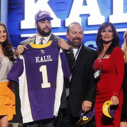 Southern California offensive lineman Matt Kalil poses for photographs with loved ones after being selected as the fourth pick overall by the Minnesota Vikings in the first round of the NFL football draft at Radio City Music Hall, Thursday, April 26, 2012, in New York.