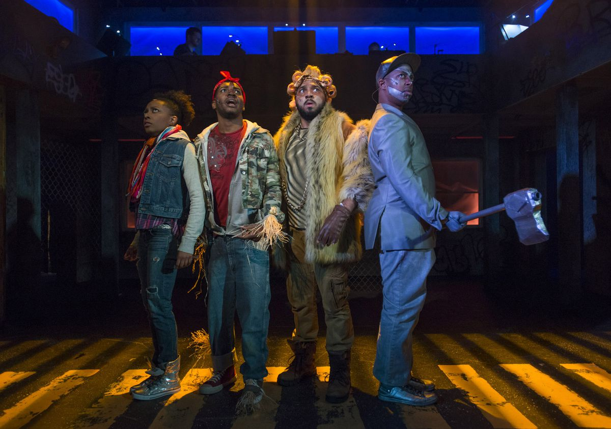 """Sydney Charles (from left) is Dorothy, Gilbert Domally is the Scarecrow, Chuckie Benson is the Lion and Steven Perkins is the Tin Man in """"The Wiz,"""" presented by Kokandy Productions at Theater Wit. (Photo: Michael Brosilow)"""